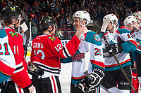 KELOWNA, CANADA - APRIL 14: Ilijah Colina #12 of the Portland Winterhawks congratulates Liam Kindree #26 of the Kelowna Rockets on the game and series win on April 14, 2017 at Prospera Place in Kelowna, British Columbia, Canada.  (Photo by Marissa Baecker/Shoot the Breeze)  *** Local Caption ***