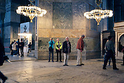 tourists feeling lost in the very large Hagia Sophia Museum Mosque Istanbul Turkey