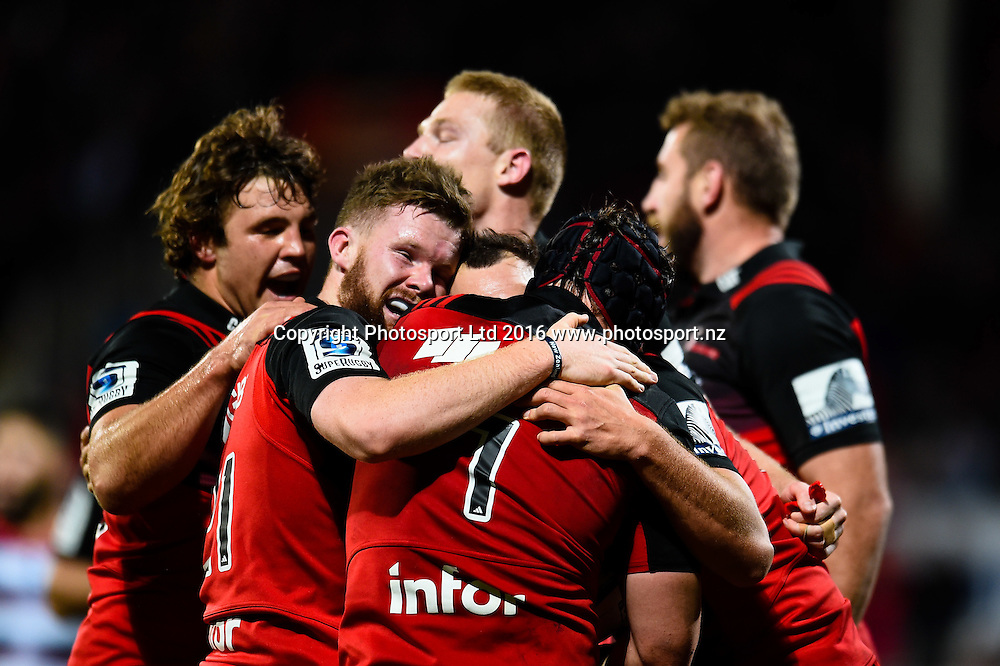 Ben Funnell and Mitchell Drummond celebrates Matt Todd of the Crusaders try during the Super Rugby Match, Crusaders V Rebels, AMI Stadium, Christchurch, New Zealand. 9th July 2016. Copyright Photo: John Davidson / www.photosport.nz