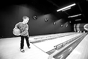Timothy attempts to work out his aim during their weekly homeschool bowling league game.