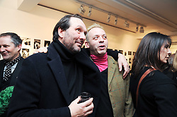 Left to right, DAVID MACMILLAN and ?   at a private view of photographs by Nick Ashley held at the Sladmore Gallery, 32 Bruton Place, London on 13th January 2010.