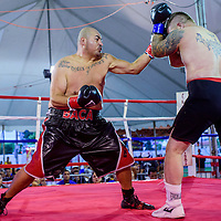 080115       Cable Hoover<br /> <br /> Ron Baca, left, jabs through a block by Manuel Otero during Fire and Ice Fury boxing in Grants Saturday.