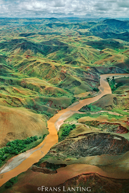 Deforested hills and silt-laden river (aerial), Central Madagascar