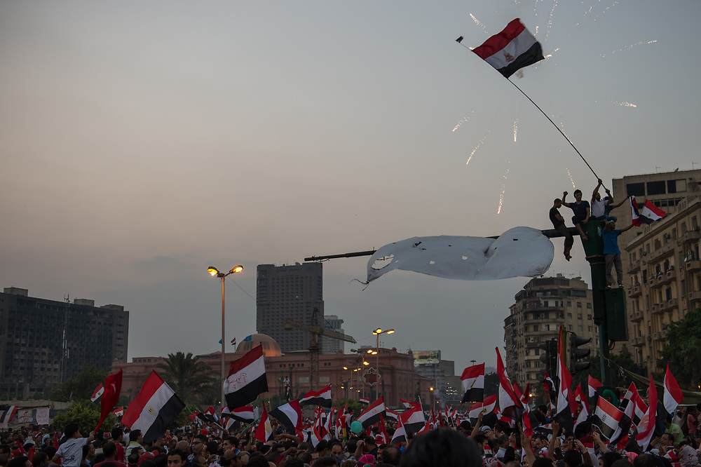 After the army ultimatum deadline expired Morsi opponents set off fireworks and wave Egyptian flags on Tahrir Square in Cairo, Egypt, July 3, 2013