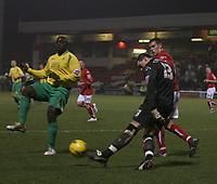 Photo: Mark Stephenson.<br />Crewe Alexander v Swansea City. Coca Cola League 1. 26/12/2006.<br />Crewe's goalkeeper Stuart Tomlinson trys to clear his goal from Swansea's Adebayo Akinfenwa.