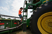 Fearless Holden Miller, 5, climbs a large John Deere combine tractor during the fourth annual International Student Farm Outing at the Schultz Family Farm in Cottage Grove, Wis., on June 24, 2012. Co-sponsored by the Schultz family and the University of Wisconsin-Madison International Student Services (ISS), the event introduced more than 100 UW-Madison international students and their families, and friends of the Schultz family to agricultural life in rural Wisconsin.