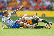 Tranmere Rovers midfielder James Norwood (10) wrestles Newport County defender Mark O'Brien (25), headlock, during the EFL Sky Bet League 2 Play Off Final match between Newport County and Tranmere Rovers at Wembley Stadium, London, England on 25 May 2019.