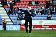 Wigan Chairman Dave Whelan addresses the fans prior to kick off. Skybet football league championship match , Wigan Athletic v Leeds Utd at the DW Stadium in Wigan, Lancs on Saturday 7th March 2014.<br /> pic by Chris Stading, Andrew Orchard sports photography.