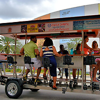 People Riding Pub Crawl Quadracycle in Fort Lauderdale, Florida <br /> All vacations are short, so when you are visiting Fort Lauderdale and can&rsquo;t decide whether to spend the day sightseeing, at the beach, sipping cocktails or maintaining your exercise regime then Cycle Party has the perfect solution for you. You and 14 other people can climb aboard their quadracycle and peddle your way towards different beaches and pubs while seeing a few of the sights along the way.