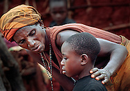 Marthe Nyirabahinzi, a Tutsi, comforts her frightened adopted daughter Bitama. Although Nyirabahinzi's children are already grown and she has several grandchildren older than Bitama, she said she could find room in her heart for Bitama. It did not matter to her that Bitama's origins are unknown, and probably Hutu.