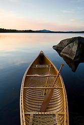 A canoe on the shoreline of Seboeis Lake near Millincoket, Maine.