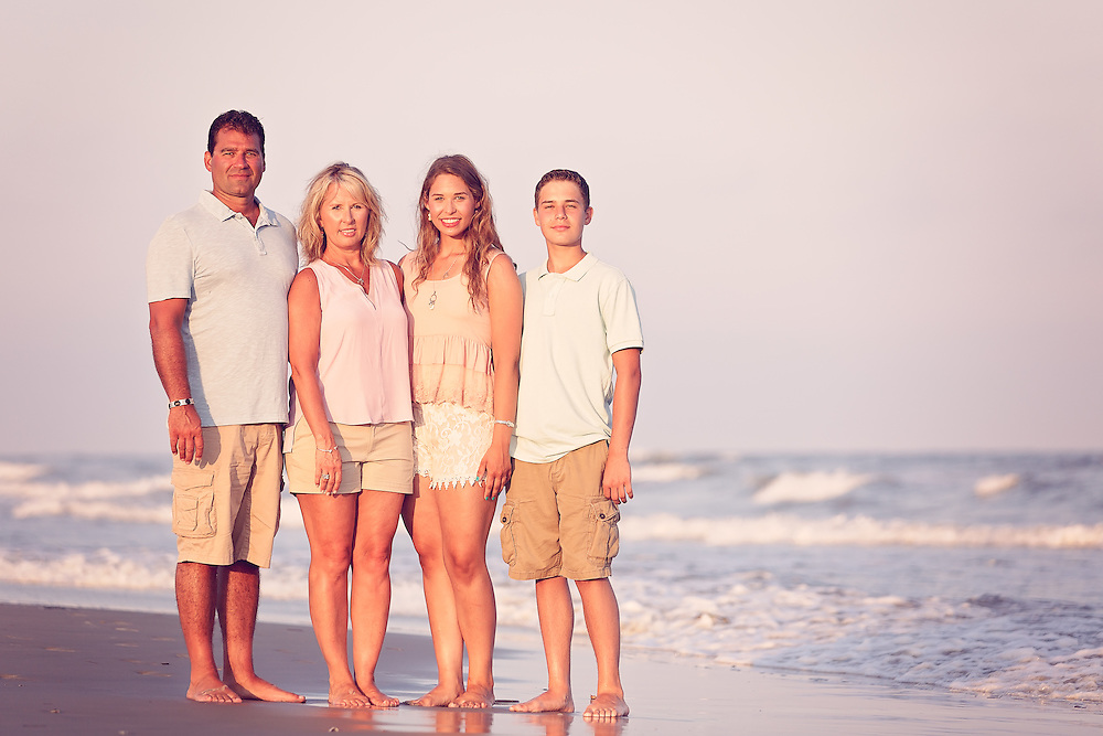 An Isle of Palms beach portrait session with the Glover family near Mt. Pleasant and Charleston, South Carolina.
