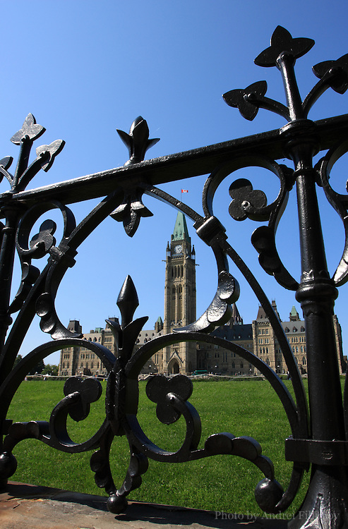 Central Block of the Canadian Parliament being seen through the iron fence - September 3, 2009. Peace Tower is the central feature of the Parliament Hill building complex surrounded by the iron fence. Unsharpened 8-bit TIFF file.