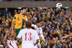 © Licensed to London News Pictures. 11/6/2013. Sasa Ognenovski heads the ball during the FIFA World Cup Qualifying match between Australia Vs Jordan at Docklands stadium, Melbourne, Australia.. Photo credit : Asanka Brendon Ratnayake/LNP