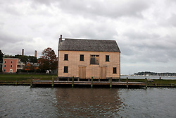 Abandoned and boarded up saltbox style building, Salem Maritime National Historic Site, Salem, Massachusetts, United States of America