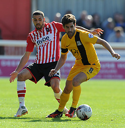 Southend United's Michael Timlin is tackled by Exeter City's Liam Sercombe - Photo mandatory by-line: Harry Trump/JMP - Mobile: 07966 386802 - 18/04/15 - SPORT - FOOTBALL - Sky Bet League Two - Exeter City v Southend United - St James Park, Exeter, England.