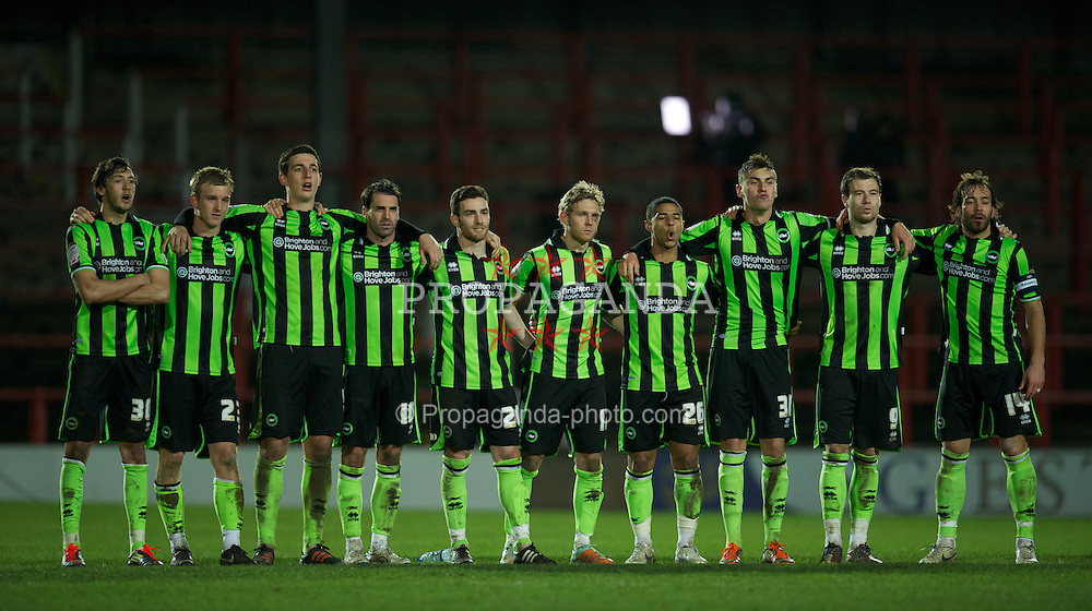 WREXHAM, WALES - Wednesday, january 18, 2012: Brighton & Hove Albion players look on during the prenalty shoot-out against Wrexham during the FA Cup 3rd Round Replay match at the Racecourse Ground. L-R: Will Buckley, Torbjorn Agdestein, Lewis Dunk, Matt Sparrow, Romain Vincelot, Craig Mackail-Smith, Liam Bridcutt, Grant Hall, Ashley Barnes, Inigo Calderon. (Pic by David Rawcliffe/Propaganda)