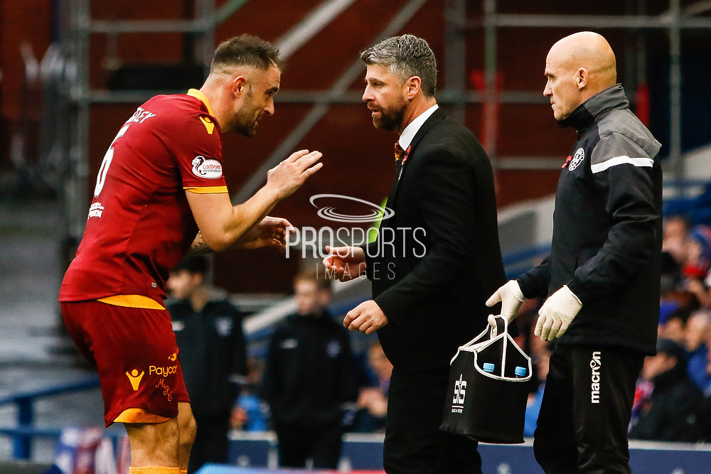Peter Hartley of Motherwell comes to the touchline to speak to Motherwell Manager Stephen Robinson following their equaliser during the Ladbrokes Scottish Premiership match between Rangers and Motherwell at Ibrox, Glasgow, Scotland on Sunday 11th November 2018.