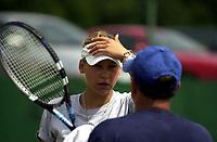Photo. Richard Lane.<br />DFS Classic Tennis at Edgebaston. 09/06/2003.<br />Anna Kournikova chats to her coach.