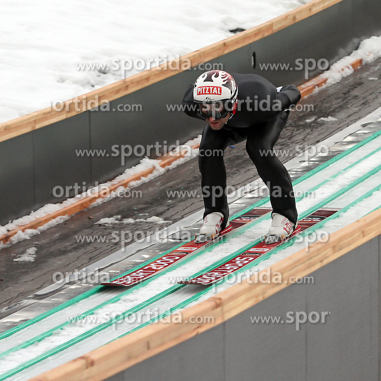 28.12.2013, Nordische Arena, Ramsau, AUT, OeSV Training, Nordische Kombination, im Bild Mario Stecher (AUT) waehrend des Skisprung-Anlauf-Trainings // Mario Stecher of Austria during a Trainingsession of Austrian Nordic Combined Team at the Nordic Arena in Ramsau, Austria on 2013/12/28, EXPA Pictures © 2013, PhotoCredit: EXPA/ Martin Huber