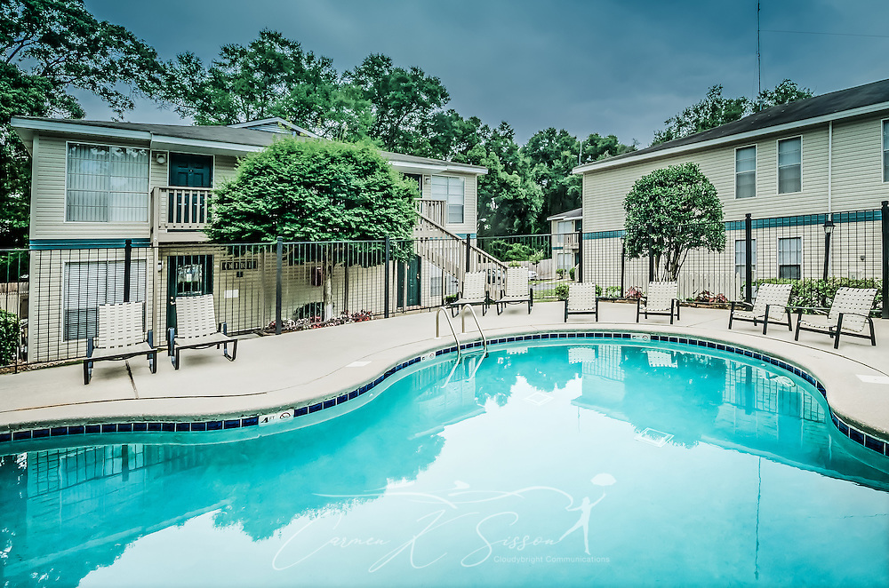 The swimming pool is shown at Robinwood Apartments, June 11, 2015, in Mobile, Alabama. The one-bedroom apartments, located on Old Shell Road, are managed by Sealy Realty. (Photo by Carmen K. Sisson/Cloudybright)