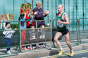 The London Marathon starts in Greenwich on Blackheath passes through Canary Wharf and finishes in the Mall. London UK, 13 April 2014