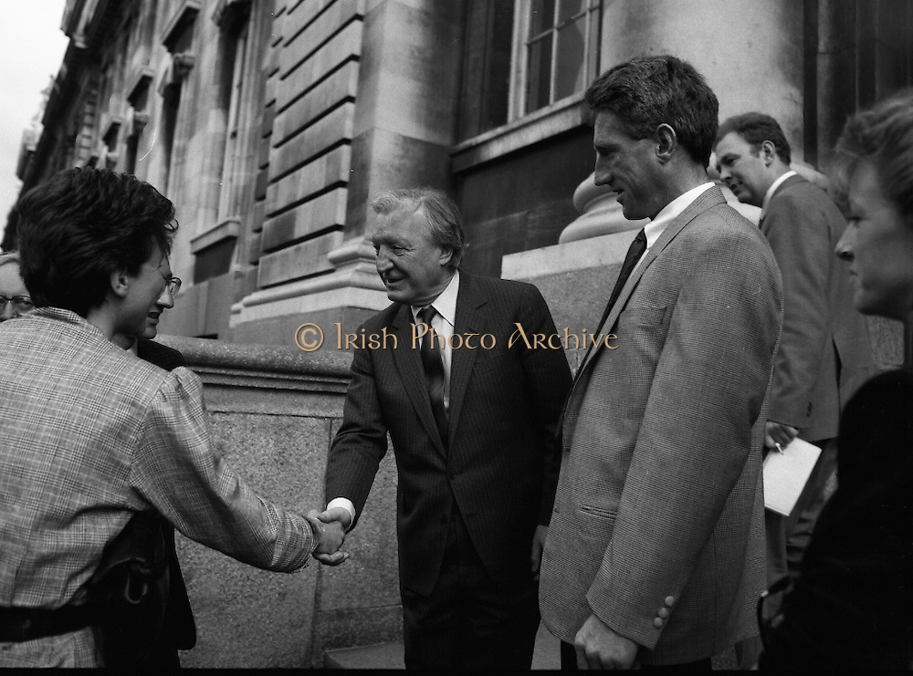 Sean Kelly Welcomed At Government Buildings. (R79).1988..19.05.1988..05.19.1988..19th May 1988..After his win in the Vuelta a España (Tour of Spain) cycle race, Sean Kelly was welcomed back to Dublin by An Taoiseach, Charles Haughey TD. He was greeted and congratulated at Government Buildings, Leinster House, Dublin...An Taoiseach, Charles Haughey shakes the hand of Mrs Catherine Earley as husband Martin, Sean and Linda Kelly look on.