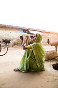 Manku Mahturi, 60, in a village in the district Bhandara where most people who were Dalits has converted to Buddhism to avoid discrimination due to the cast system, Maharashtra, India<br /> <br /> Photo by Christina Sjögren<br /> <br /> <br /> Manku Mahturi, 60, i en by i distriktet Bhandara där de flesta kastlösa har konverterat till buddismen för att undkomma diskriminering på grund av kastsystemet, Maharashtra, Indien