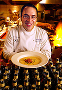 Rivers Restaurant in the Mercantile Exchange Building - Chef Matthew Koury holds a bowl of roasted corn soup topped with tomato and onion confit.
