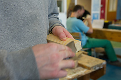 A prisoner learning the carpentry trade in a workshop HMP Featherstone
