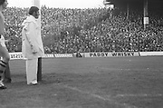 Umpire stands by the goal as the stands are full of supporters for the All Ireland Senior Gaelic Football Final, Kerry v Dublin in Croke Park on the 28th September 1975. Kerry 2-12 Dublin 0-11.