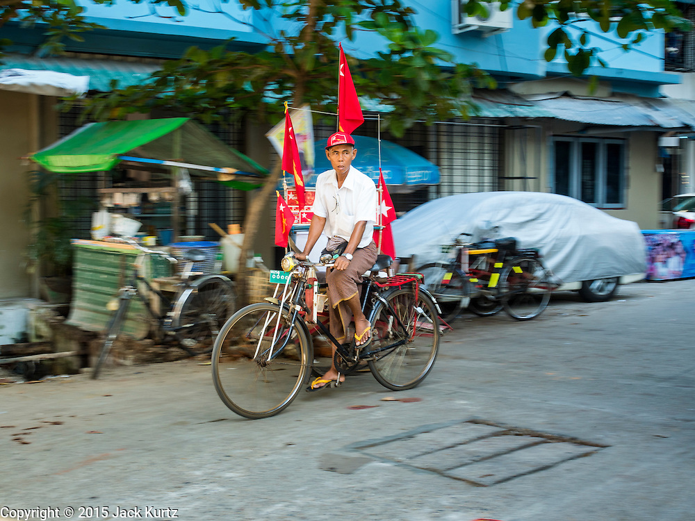 04 NOVEMBER 2015 - YANGON, MYANMAR:  A pedicab driver who supports the NLD and Aung San Suu Kyi  in Yangon. National elections are scheduled for Sunday Nov. 8 in Myanmar. The two principal parties are the National League for Democracy (NLD), the party of democracy icon and Nobel Peace Prize winner Aung San Suu Kyi, and the ruling Union Solidarity and Development Party (USDP), led by incumbent President Thein Sein. There are more than 30 parties campaigning for national and local offices.        PHOTO BY JACK KURTZ