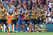 Arsenal celebrate their second goal whilst Yohan Cabaye of Crystal Palace questions what happened during the Barclays Premier League match between Crystal Palace and Arsenal at Selhurst Park, London, England on 16 August 2015. Photo by Ellie Hoad.