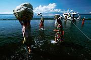 Kusamba, black volcanic beach. Arrival of the ferry boat from Penida Island.