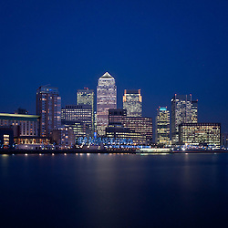 Illuminated skyscrapers of the financial district of Canary Wharf in London at night