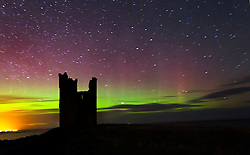 FILE PICTURE © Licensed to London News Pictures. 22/01/2012. London, UK. Aurora seen above Lilburn tower, which is part of Dunstanburgh Castle, near Embleton Bay in Northumberland, UK, on the evening of 22 January 2012. The Aurora Borealis, known as The Northern Lights, which normally appear above Iceland and Norway, were seen further south this weekend due to unusual solar activity. Photo credit : Mike Ridley/LNP