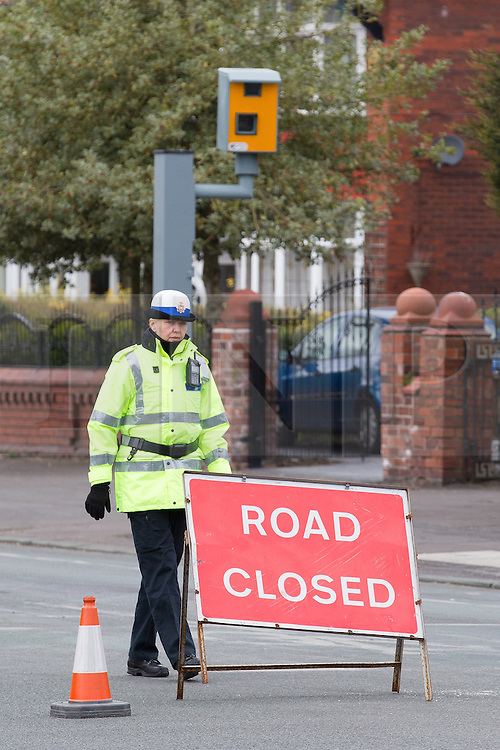 © Licensed to London News Pictures . 01/03/2013 . Manchester , UK . Police close on Wilbraham Road , Chorlton , Manchester today (1st March 2013) . Police report they are investigating following the discovery of a body this morning (1st March) . Photo credit : Joel Goodman/LNP