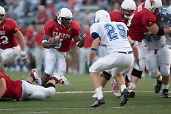 10 Sep 2005<br /> <br /> Brian Thompson cuts through a hole that is partially blocked by Andy Green.<br /> <br /> Illinois State University V Drake.  Hancock Stadium, Illinois State University, Normal IL
