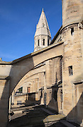 Flying butresses of the Collegiale Notre-Dame de Poissy, showing the Western bell tower and chapels of the North aisle, a catholic parish church founded c. 1016 by Robert the Pious and rebuilt 1130-60 in late Romanesque and early Gothic styles, in Poissy, Yvelines, France. Saint Louis was baptised here in 1214. The Collegiate Church of Our Lady of Poissy was listed as a Historic Monument in 1840 and has been restored by Eugene Viollet-le-Duc. Picture by Manuel Cohen