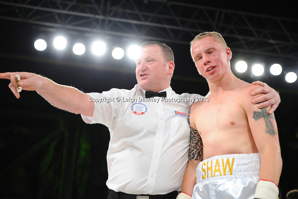 Referee Howard Foster calls Martin Shaw's corner to get his stool ready for him to be seated after the fight was stopped. Sam O'maison v Martin Shaw. Saturday 14th September 2013 at the Magna Centre, Rotherham. Hennessy Sports. Self billing applies. © Credit: Leigh Dawney Photography.