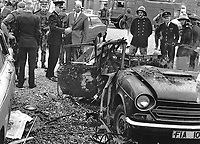 Tangled remains of the booby-trapped family car in which 3 year old Michele O'Connor died on 13th June 1975. John O'Connor, who survived but was very seriously injured, was routinely taking his daughter to nursery school. The blast occured outside their home in Sunnyside Street, Belfast, N Ireland, UK, 197506130222<br /> <br /> Copyright Image from Victor Patterson, 54 Dorchester Park, Belfast, UK, BT9 6RJ<br /> <br /> Tel: +44 28 9066 1296<br /> Mob: +44 7802 353836<br /> Voicemail +44 20 8816 7153<br /> Email: victorpatterson@me.com<br /> <br /> <br /> IMPORTANT: If you wish to use this image or any other of my images please go to www.victorpatterson.com and click on the Terms & Conditions. Then contact me by email or phone with the reference number(s) of the image(s) concerned.