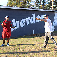 RAY VAN DUSEN/BUY AT PHOTOS.MONROECOUNTYJOURNAL.COM<br /> First-year Aberdeen head baseball coach Seth Dover, right, instructs potential players about batting on the second day of practice for the upcoming season.