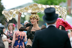 © London News Pictures. 20/06/2013. Ascot, UK. A woman wears a hat designed by Larisa Katz. Ladies Day on day three of Royal Ascot at Ascot racecourse in Berkshire, on June 20, 2013. The 5 day showcase event, which is one of the highlights of the racing calendar, has been held at the famous Berkshire course since 1711 and tradition is a hallmark of the meeting. Top hats and tails remain compulsory in parts of the course.  Photo credit : Stephen Simpson/LNP