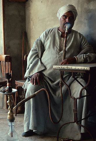 December 1993, Al Fayyum, Egypt --- Man Smoking a Hookah Water Pipe --- Image by © Owen Franken/CORBIS