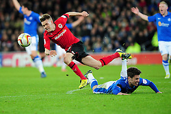 Cardiff City's Graig Noone  fouls Peterborough United captain, Tommy Rowe and then trips over him - Photo mandatory by-line: Dougie Allward/JMP  - Tel: Mobile:07966 386802 15/12/2012 - SPORT - FOOTBALL -  Championship -  Cardiff-  New Cardiff City Stadium  -  Cardiff City v Peterborough United
