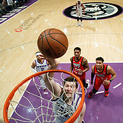 Reno Bighorns Center JACK COOLEY (45) shoots as two Raptors 905 defenders look on during the NBA G-League Basketball game between the Reno Bighorns and the Raptors 905 at the Reno Events Center in Reno, Nevada.