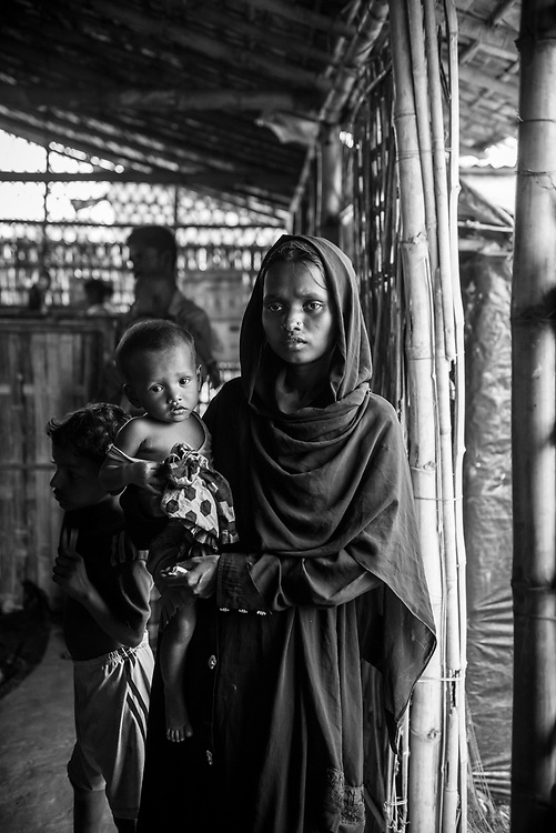 Sabika, age 8 months, with her mom, Rahima, age 23, at a Concern Worldwide/UNICEF clinic for severe acute malnutrition (SAM).  They are from Cho Para in Myanmar. (October 30, 2017)