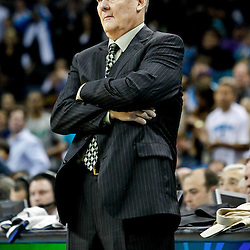 October 29, 2010; New Orleans, LA, USA; Denver Nuggets head coach George Karl watches from the bench during the fourth quarter against the New Orleans Hornets at the New Orleans Arena. The Hornets defeated the Nuggets 101-95.  Mandatory Credit: Derick E. Hingle