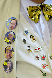 © Licensed to London News Pictures. 01/03/2013. Eastleigh, UK. Badges on HOWLING LAUD HOPE of the Monster Raving Loony William Hill Party's waistcoat. Ballot boxes begin to arrive at the count centre at  Fleming Park Leisure Centre in Eastleigh this evening. The voters of Eastleigh vote to choose a new MP in a by-election prompted by the resignation of former Lib Dem cabinet minister Chris Huhne. Polling will continued 22:00 GMT 28/02/13, with votes counted overnight on Thursday. There are 14 candidates in total on the ballot papers.. Photo credit : Stephen Simpson/LNP