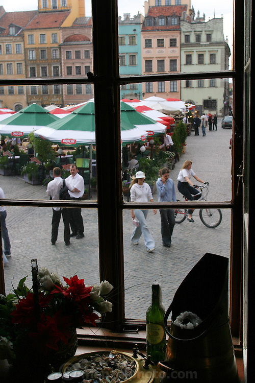 Old Town Square through a restaurant window. Warsaw, Poland.